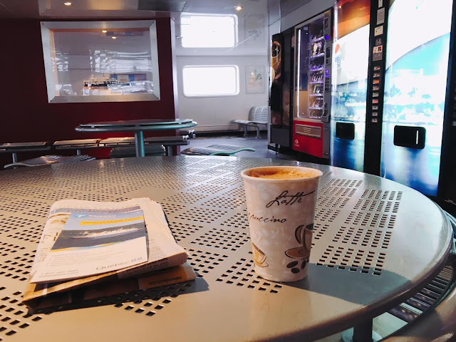 coffee and newspaper inside the the Lévis Ferry
