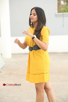 Actress Poojitha Stills in Yellow Short Dress at Darshakudu Movie Teaser Launch .COM 0043.JPG