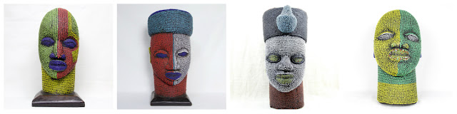 Carved wood head sculptures covered in beads by Kronbali