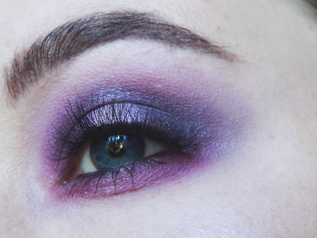 Close up of a smokey purple halo inspired makeup look