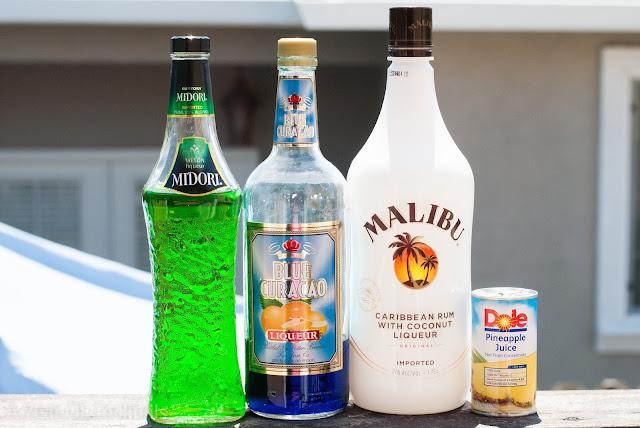 Green Tropics cocktail, coconut rum, malibu rum, pineapple juice, blue curacao, melon liqueur, midori