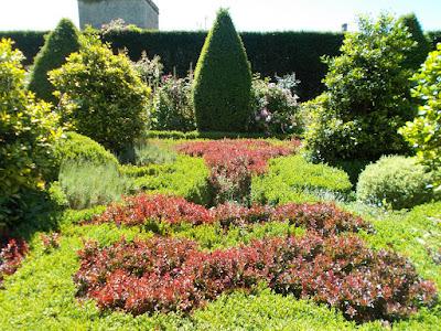 Multi coloured topiary A Garden Design Masterclass at Abbey House Gardens