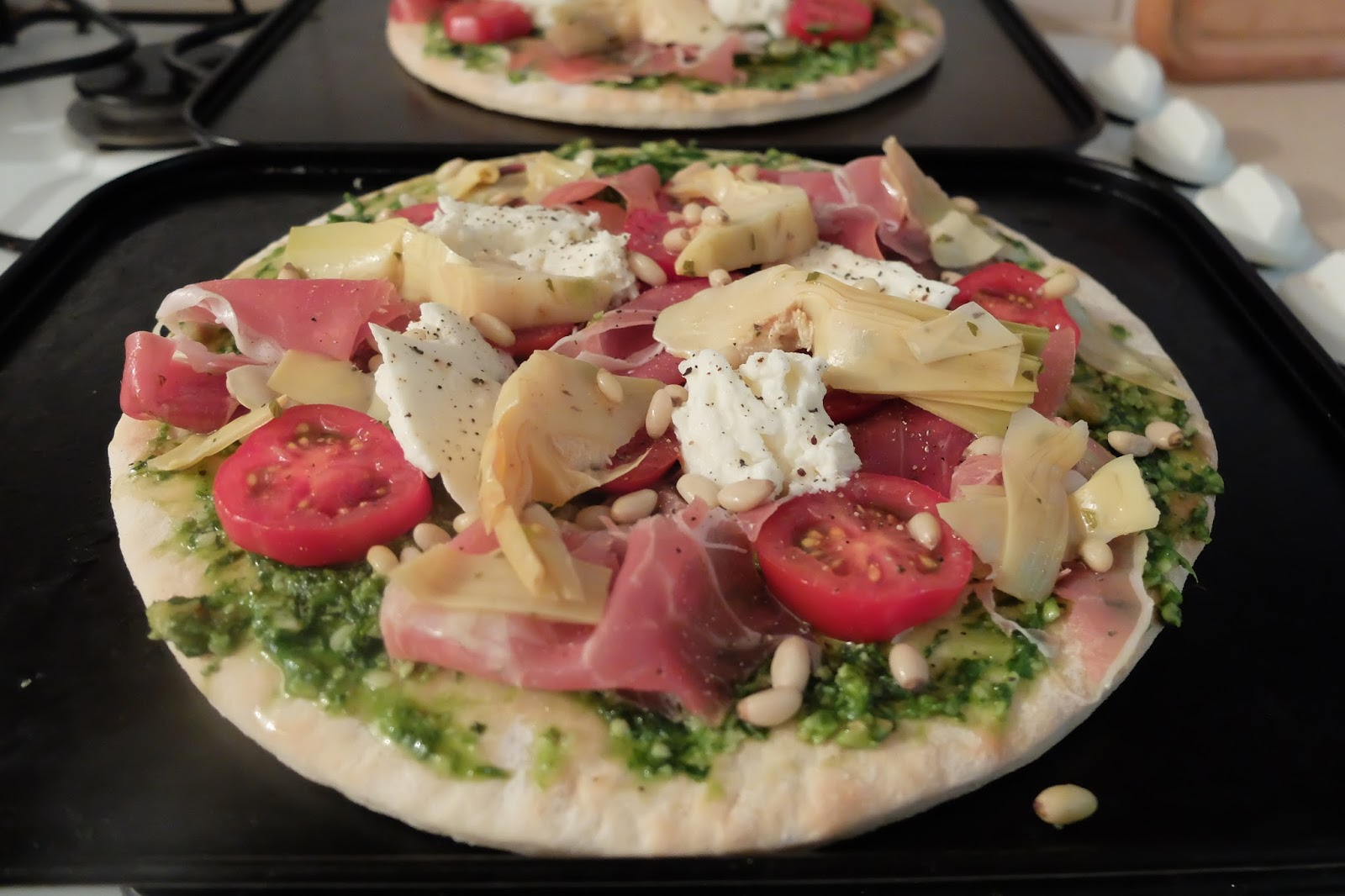 Artichoke, Mozzarella, Tomato, Pine nut, Parma Ham Pizza With Wild Garlic Pesto