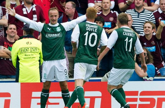 Leigh Griffiths celebrates his goal against Hearts with Hibernian teammates