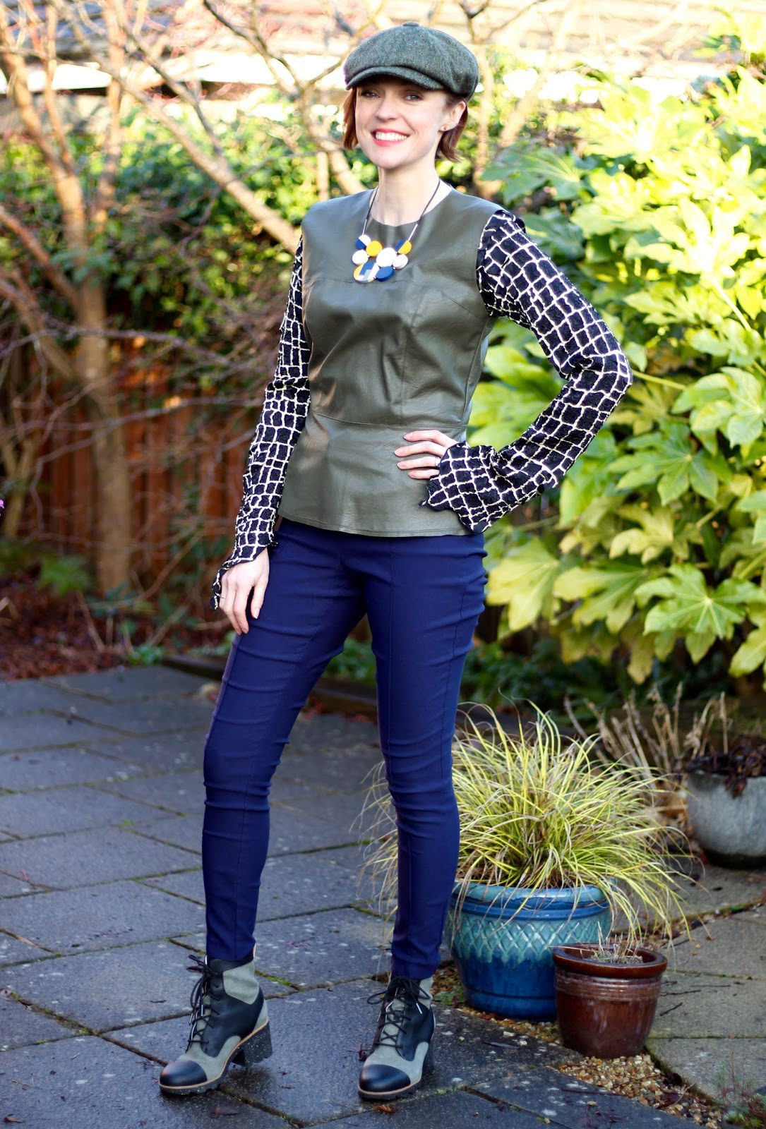 Fake Fabulous | Fluted sleeves, green leather top, Flat Cap, Navy Trousers and Chunky Boots!