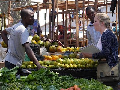 FIP Student, Lindsay, interviews a retailer in Lilongwe's Tsoka Market. Credit: Alyssa Cleland