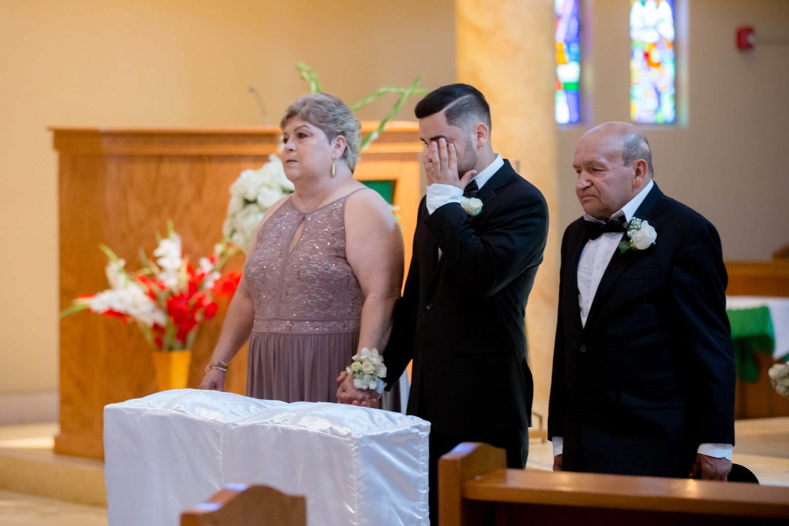 Groom with Parents at the Altar