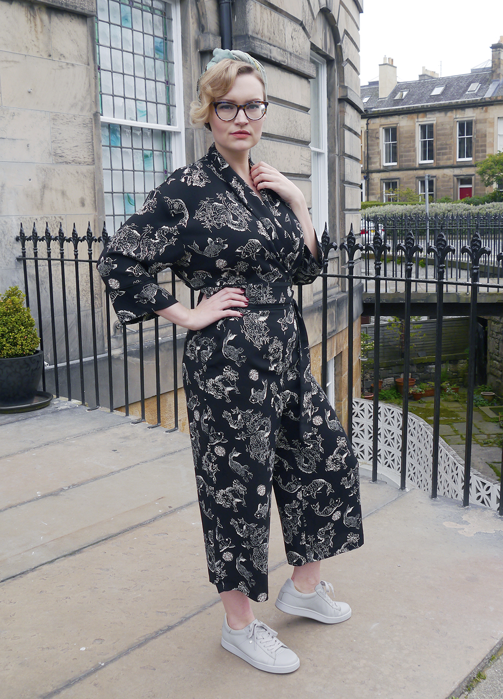 Top Scottish fashion blogger Kimberley from Wardrobe Conversations wears a black print Biba jumpsuit and headwrap for an easy Sunday cocktail look