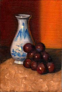 Oil painting of a miniature white and blue porcelain vase beside a small bunch of red grapes.