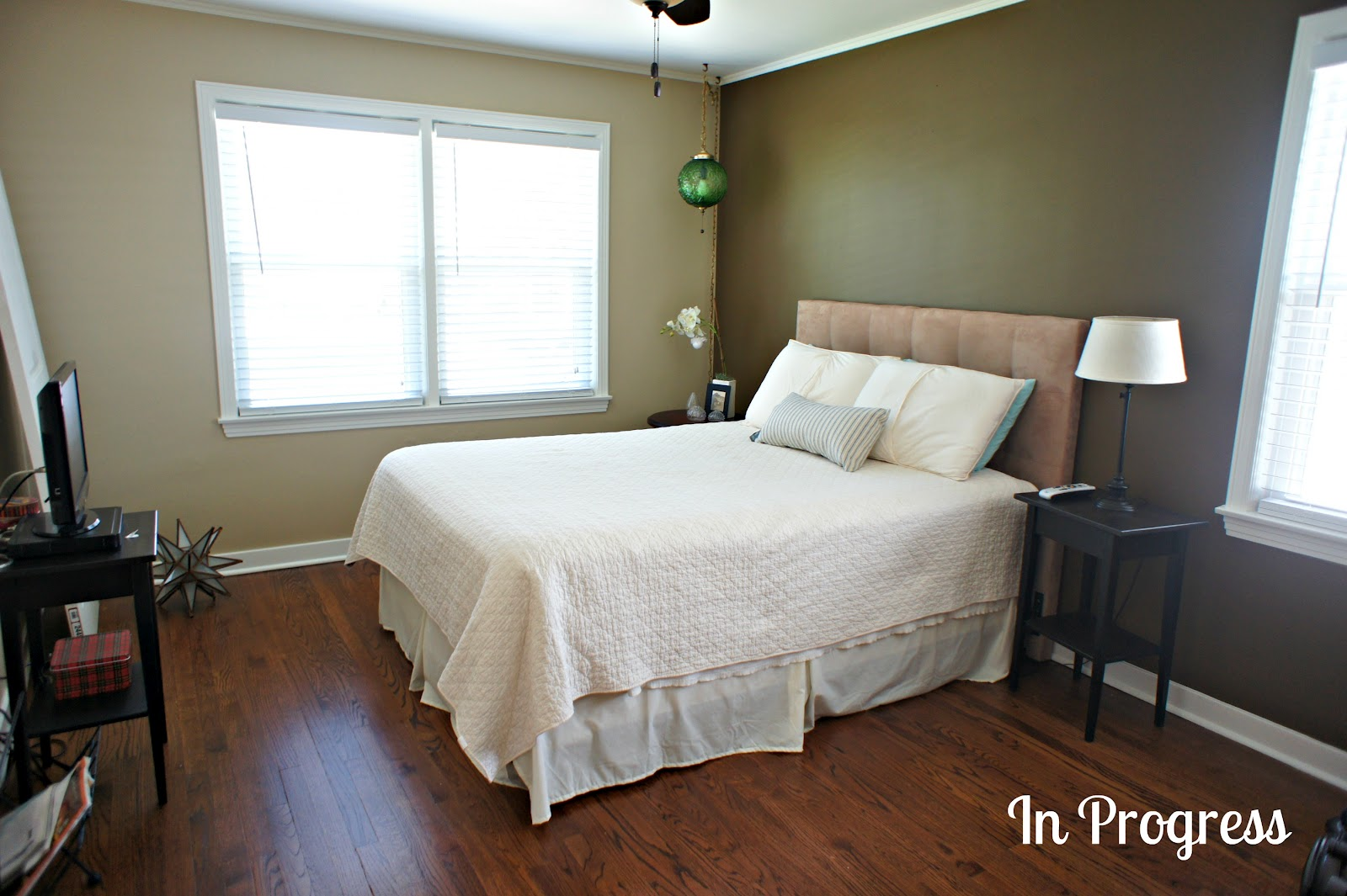 Charming Master Bedroom Green Accent Wall