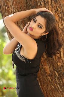 Actress Poojitha Pallavi Naidu Stills in Black Short Dress at Inkenti Nuvve Cheppu Movie Platinum Disc Function  0030.JPG