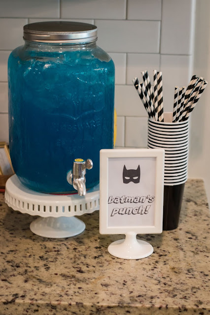 punch and paper straws at a batman party