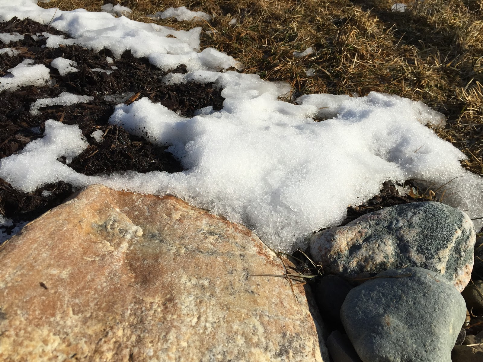 melting snow on rocks