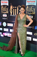 Nikesha Patel in Glittering Leg Split Deep Neck Green Gown at IIFA Utsavam Awards 2017     11.JPG