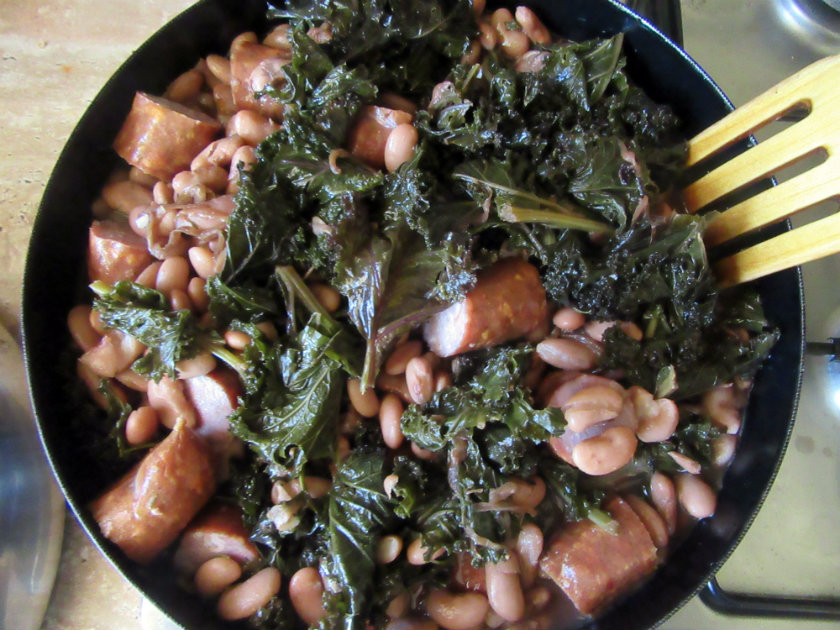 Collard greens with white beans and sausage by Laka kuharica: add the beans, sausage and the remaining bean cooking liquid