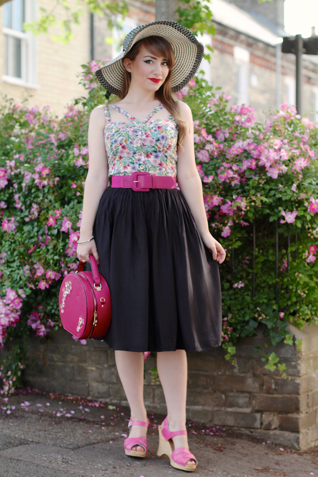 Pink flowers, a floppy sunhat and the usual 50s inspired look