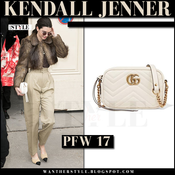 Kendall Jenner with cream Gucci GG marmont mini camera bag, fur jacket and high waist trousers what she wore paris fashion week 2017