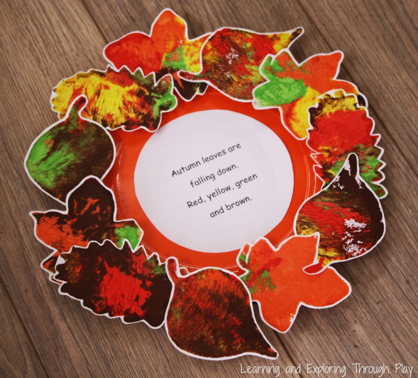 Learning And Exploring Through Play Leaf Wreath Poem