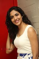 Actress Ritu Varma Stills in White Floral Short Dress at Kesava Movie Success Meet .COM 0110.JPG
