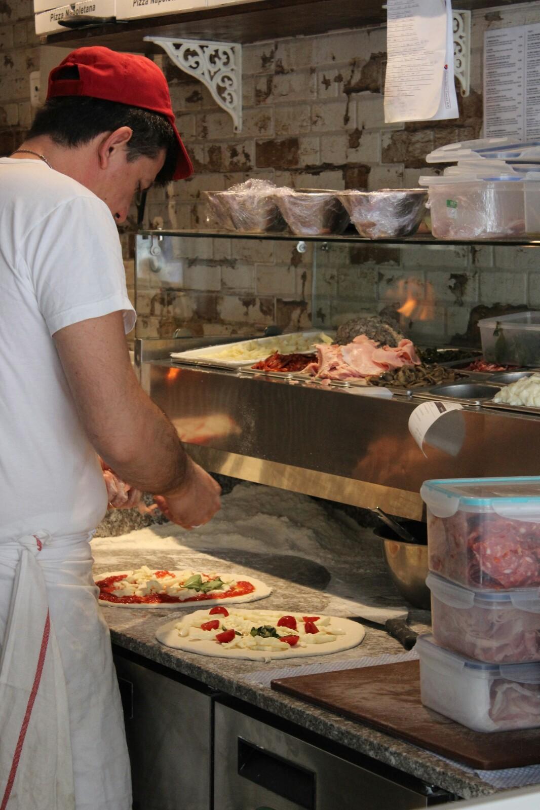 Preparing the pizzas