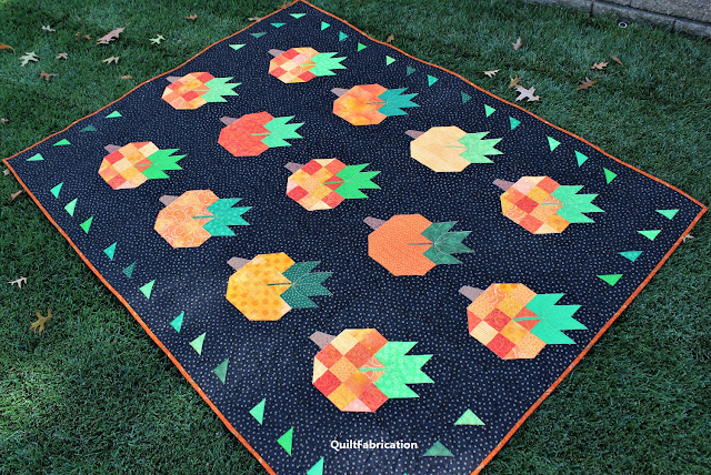 Pumpkin Harvest pumpkin quilt in the field by QuiltFabrication