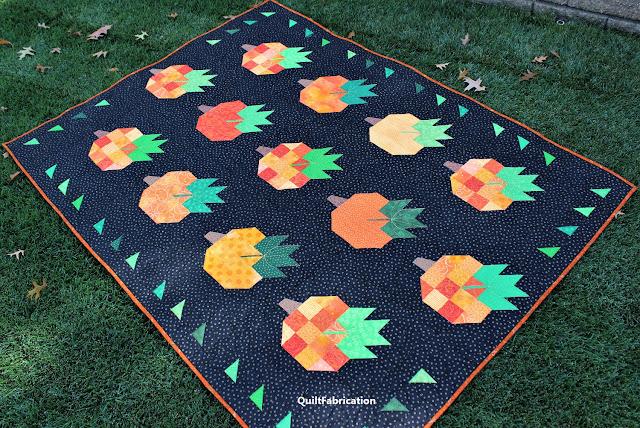 Pumpkin Harvest pumpkin quilt in the field by QuiltFabrication