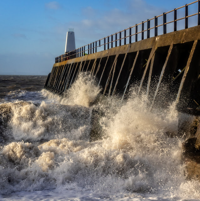 Photo of powerful waves breaking against Maryport pier