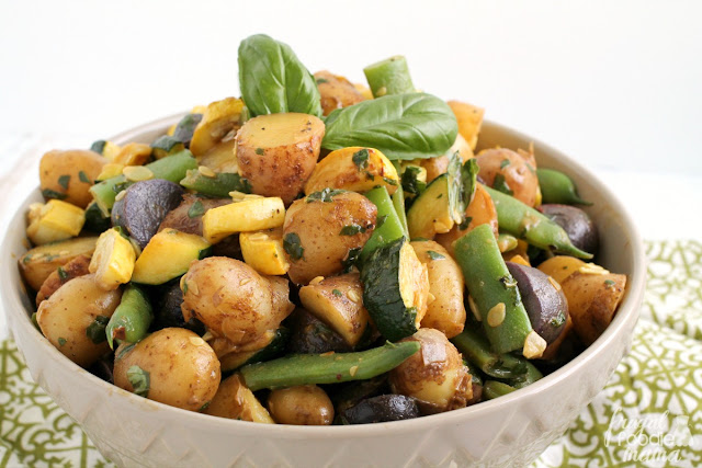 The freshest locally grown potatoes & veggies come together perfectly with a super simple 3 ingredient fresh basil dressing in this Summer Harvest Potato Salad.
