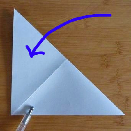 folding square sheet of paper into a triangle shape