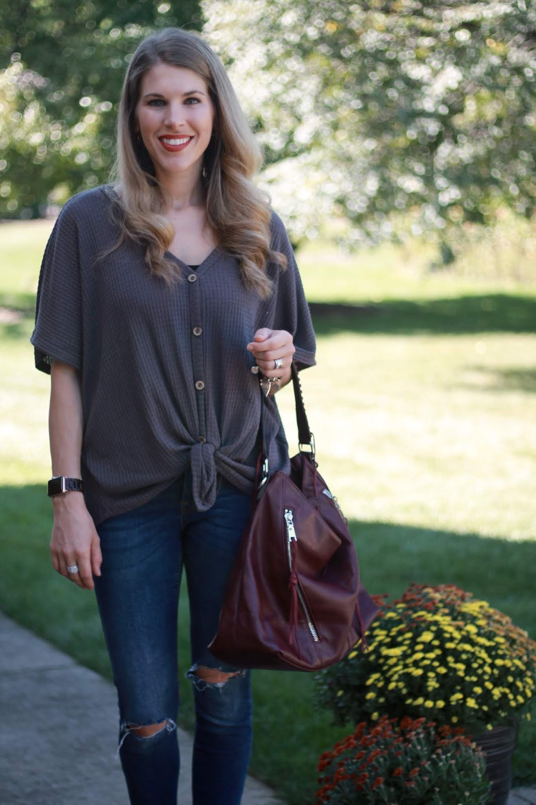 grey tie front dolman top, distressed jeans, burgundy hobo bag, peep toe booties