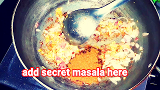 image of adding secret masala in kadhai