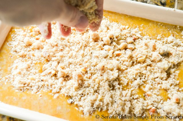 Pumpkin Cobbler recipe spread topping evenly over pumpkin mixture from Serena Bakes Simply From Scratch.