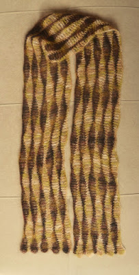 Scarf is laid out as flat as possible to clearly show the wavy patterns.