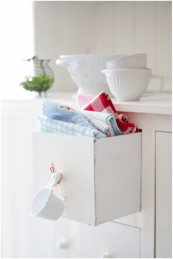 a drawer of kitchen linens