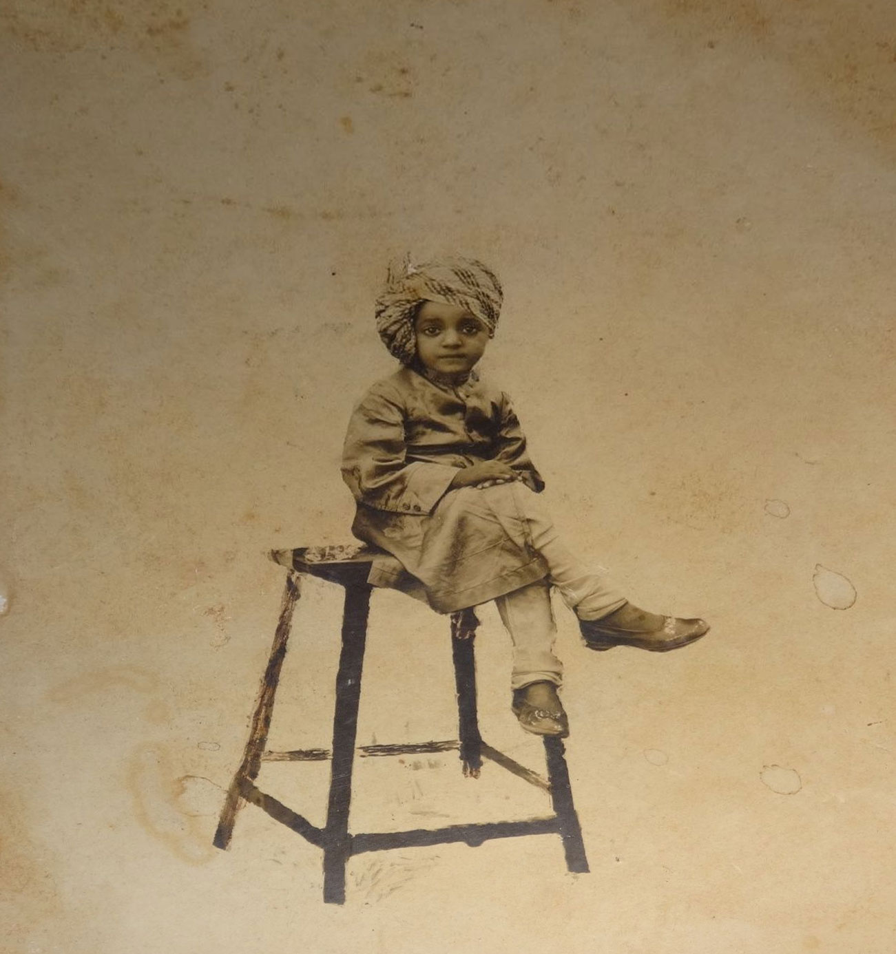 Indian Royal Child Siting on a Stool