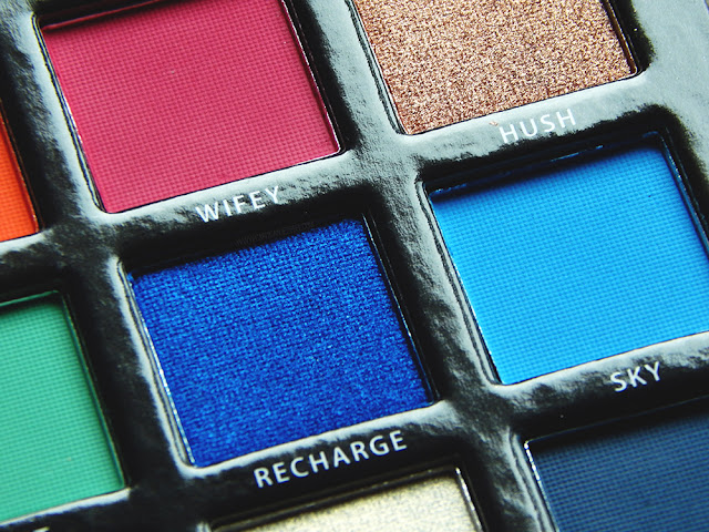 "BPerfect Cosmetics x Stacey Marie Carnival Palette Review a close up of shade ""recharge"" and Sky"" a dark blue glitter shade and a aqua blue matte eyeshadow"