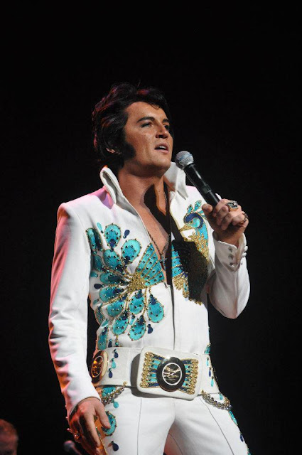 Ben porstmouth wearing peacock suit performing as Elvis impersonator