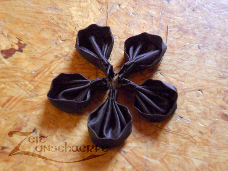 five finished fabric petals