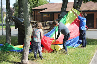 We used ropes, sheets, blankets and a parachute to make one giant den.