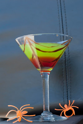 Halloween cocktail, Midori, melon liqueur, vodka, lemon juice