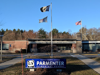 Parmenter School flags in breeze blowing the other way