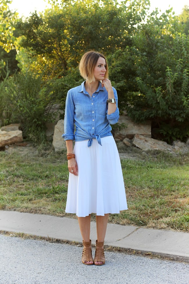 Chambray shirt, white pleated skirt, and caged tan sandals