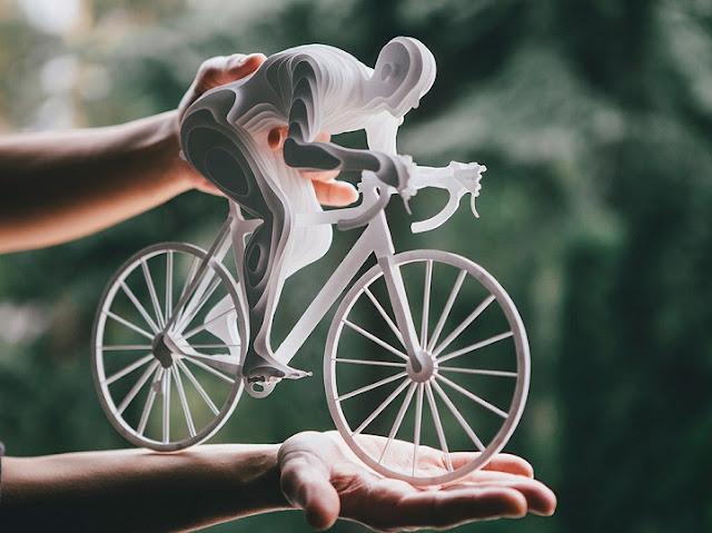 Artisca cria belas esculturas de papel para capturar a força e a graça dos atletas olímpicos