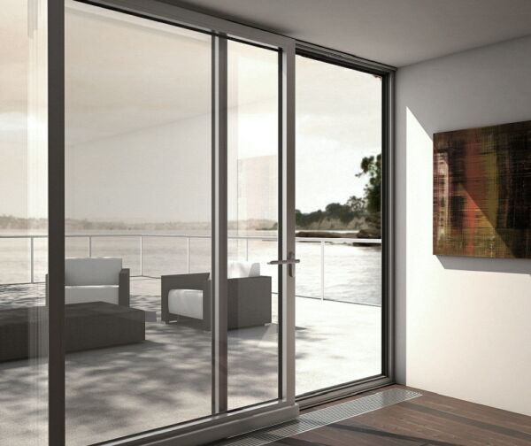 Puertas para balcones cerramientos terrazas persianas y for Puertas corredizas aluminio para exterior