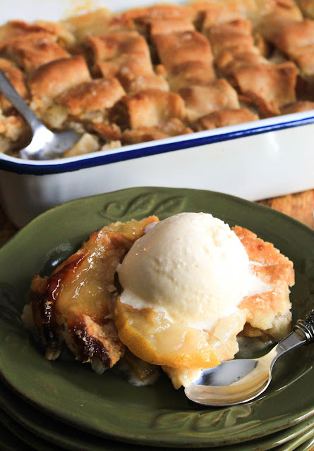 Pear Dumpling Cobbler, a simple and delicious recipe of juicy pears cooked to perfection in a sweet buttery sauce between two layers of dumpling dough.   A gorgeous presentation for an elegant dinner.