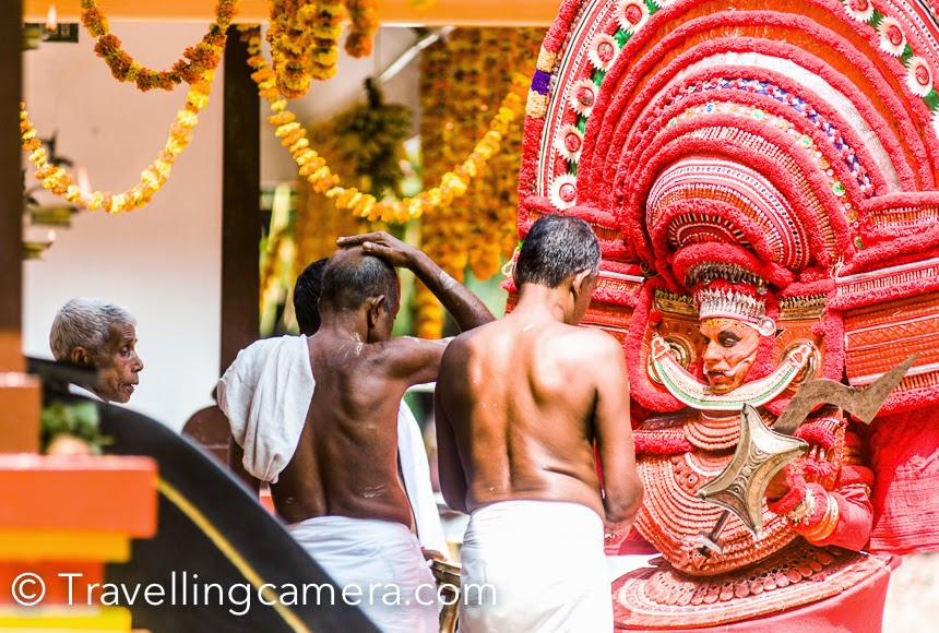 The first Theyyam to perform was pulimaran, a reincarnation of Vishnu. This Theyyam had a large but manageable headdress, but looked fierce with his kohl-lined eyes that were like marbles in the sockets. Pulimaran danced and performed prayers at the main temple and then went around temple complex blessing people and distributing Prasadam.