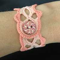 crocheted bracelet in peach tones