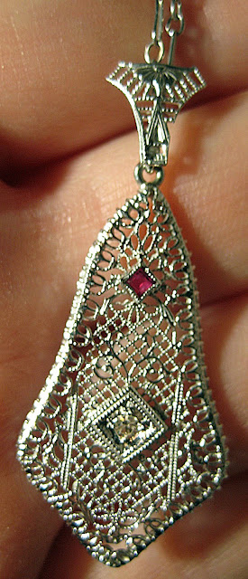 Art Deco diamond and ruby filigree pendant.