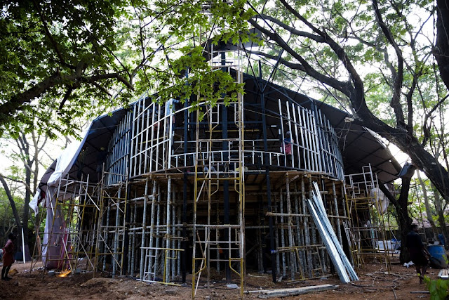 The Pavilion's rugged exterior uses recycled debris and discarded materials from Fort Kochi
