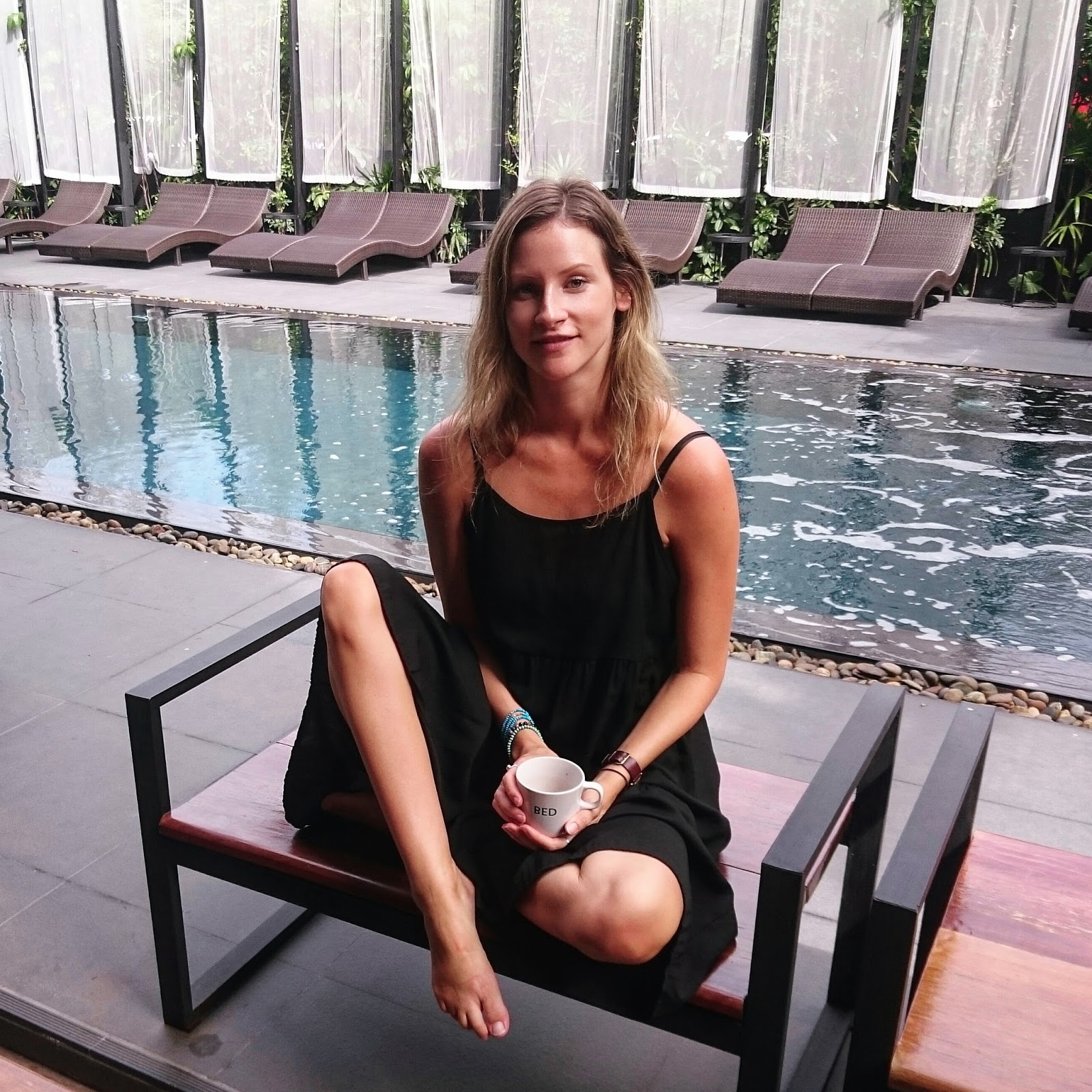 Travel blogger and digital nomad, Alison Hutchinson, is relaxing by the pool at BED Nimman Hotel in Chiang Mai